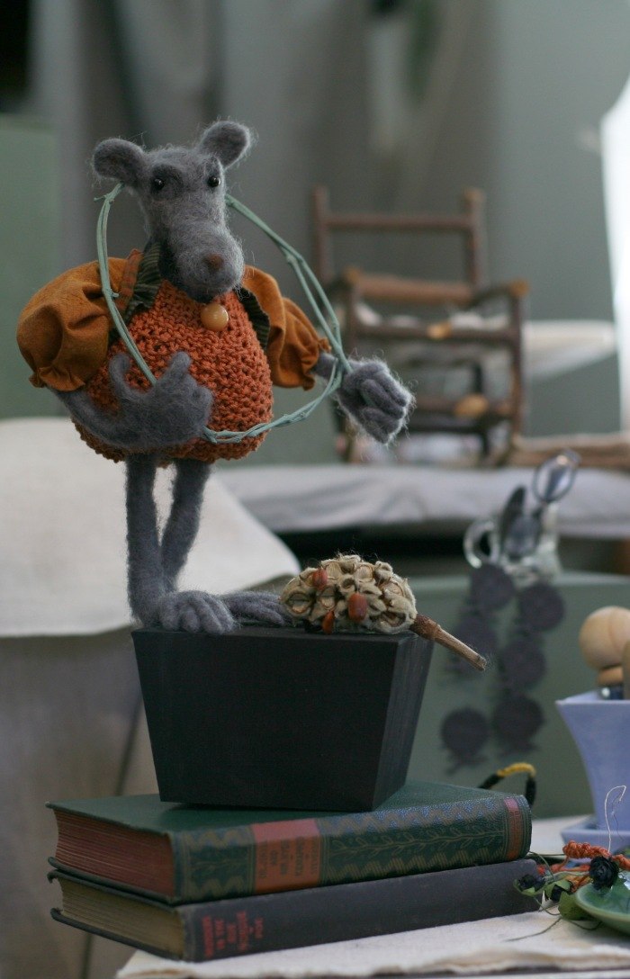 Felted small animal in knitted pumpkin costume